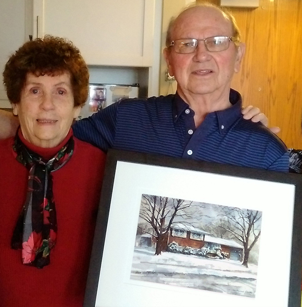 Lucy Schitos customers with the portrait of their home by Alex Krajewski commissioned by Lucy