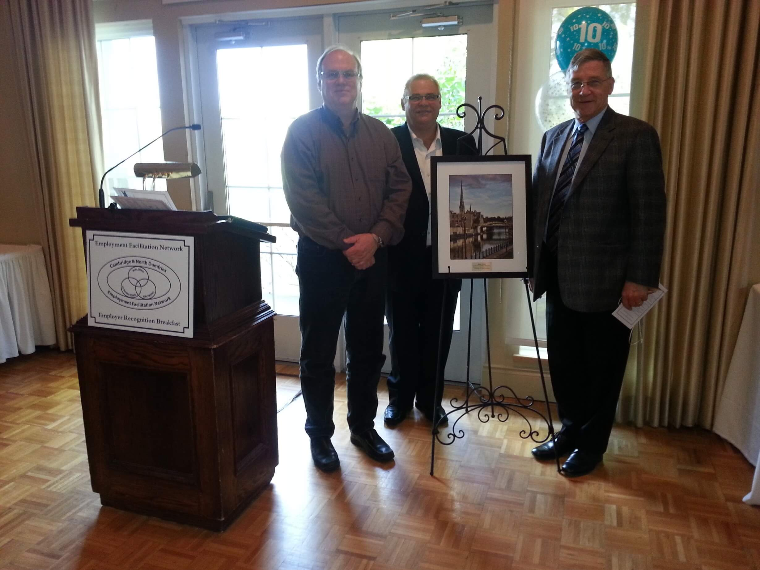 Canadian artist, Alex Krajewski with the President of Cambridge Chamber of Commerce, Greg Durocher and Regional Chair, Ken Sailing