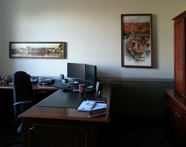Framed prints of  Cambridge on the wall at an office at Gore Mutual Insurance