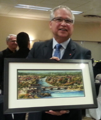 Presentation of Alex Krajewski's Cambridge print to the past MPP Gary Goodyear during a Cambridge Chember of Commerce morning event