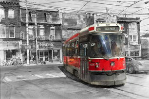 """Carlon Turn"" by Alex Krajewski is a photograph of a red TTC streetcar turning in Toronto, Ontario"