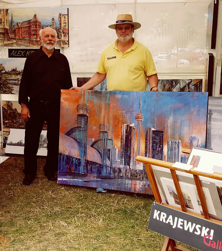 Canadian artists Alex Krajewski at Home County Folk Festival in London Ontario with a customer