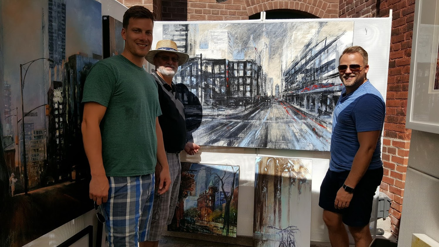 Canadian artist Alex Krajewski at an ArtFest at Destillery in Toronto Ontario with happy customers