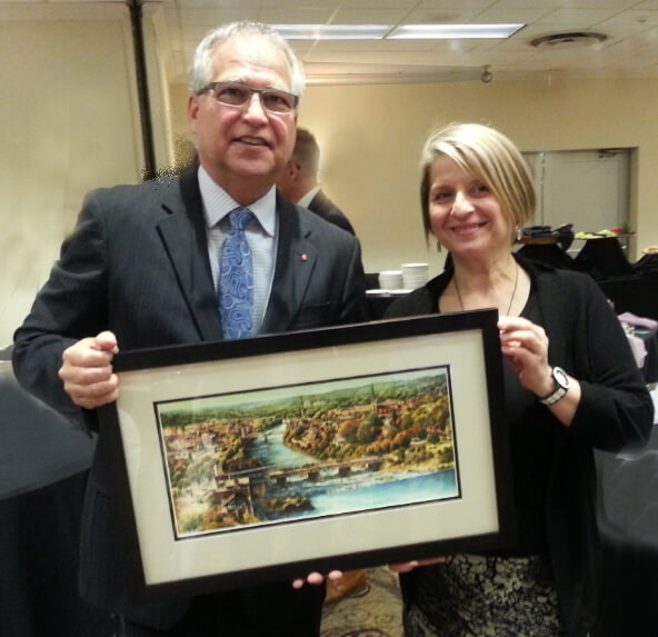 "The Honourable Gary Goodyear, Minister of State, presented by Cambridge Chamber of Commerce with  ""Cambridge Panorama"" by Alex Krajewski"