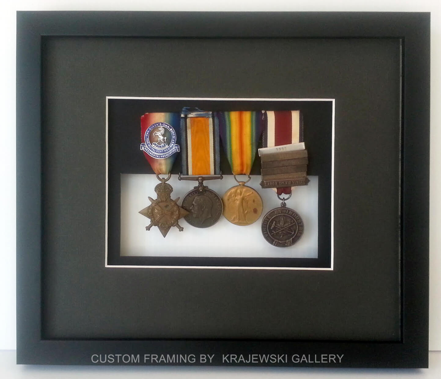 Custom Picture Framing by Krajewski Gallery: World War 2 medals custom framed with glass in the back showing off the other side